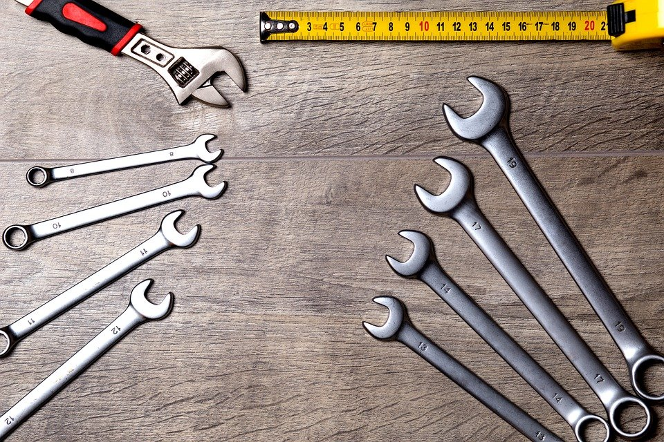 Wrench tools placed on a wooden surface