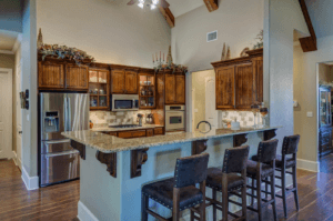 A kitchen interior with wooden cabinets